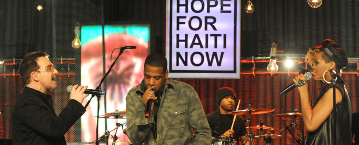 Bono, Jay-Z, and Rihanna perform together on stage at the Hope For Haiti Now concert