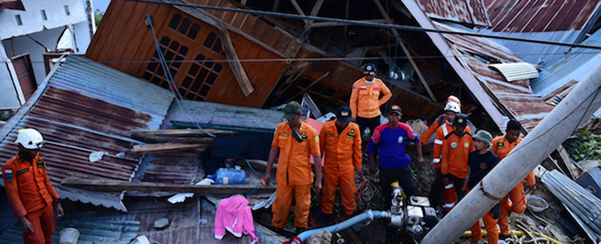 rescue workers combing through the rubble after the Indonesian earthquake and tsunami