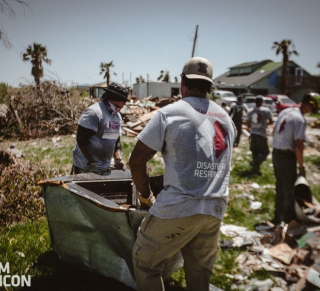 Volunteers removing debris in the tropical heat