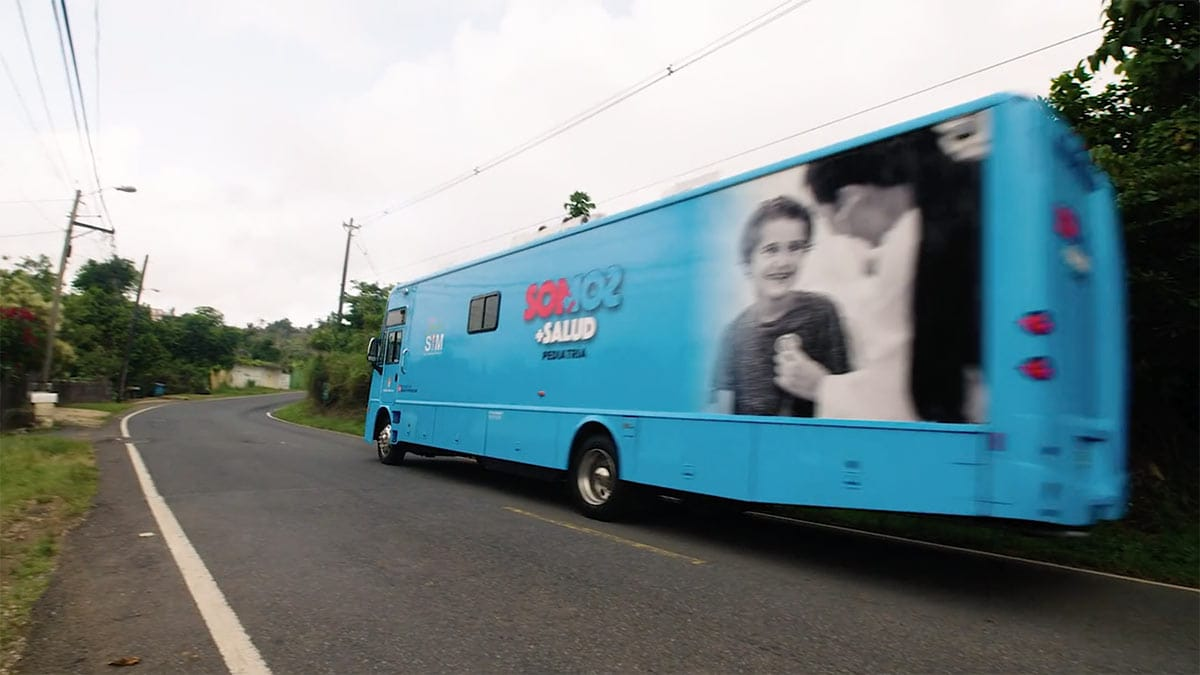 the Salud Integral mobile pediatric clinic on a road in Puerto Rico