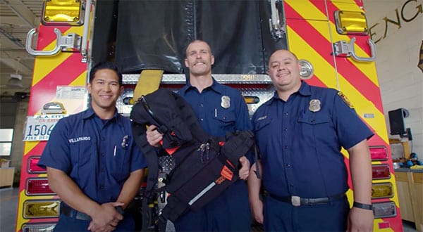 Three LA firefighters with a hydration pack